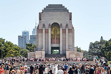 View of the Southern front of the ANZAC Memorial Centenary project in Hyde Park, Sydney. The building is surrounded by a crowd of people.